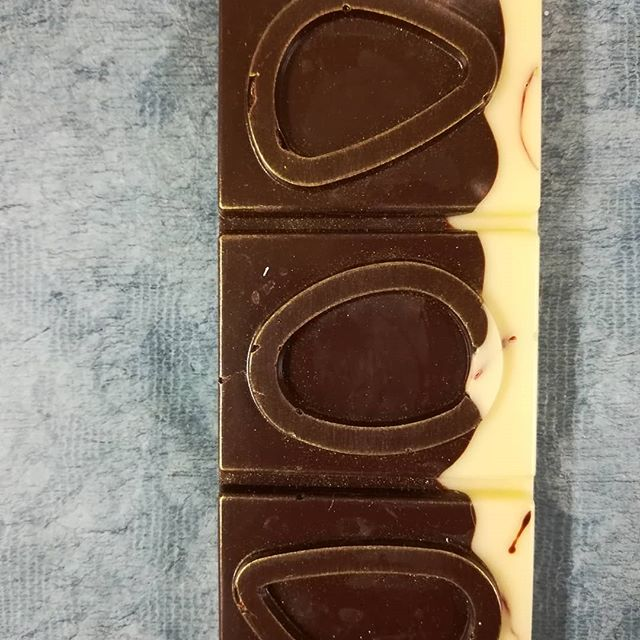 A few new bars in the lineup. RARE EARTH is precious saffron and Dick Taylor Belize 70% layered over Valrhona's Yuzu-infused cocoa butter.#chocolatier #chocolatebar #darkchocolate #yuzu #saffron @dicktaylorchocolate @valrhonausa @epicesdecru