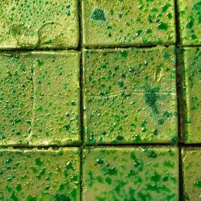 Squares of Pistachio Gianduja for Bonbon Sharing Boxes. Shipping lots if chocolate.#chocolatier #chocolate #pistachio #gianduja