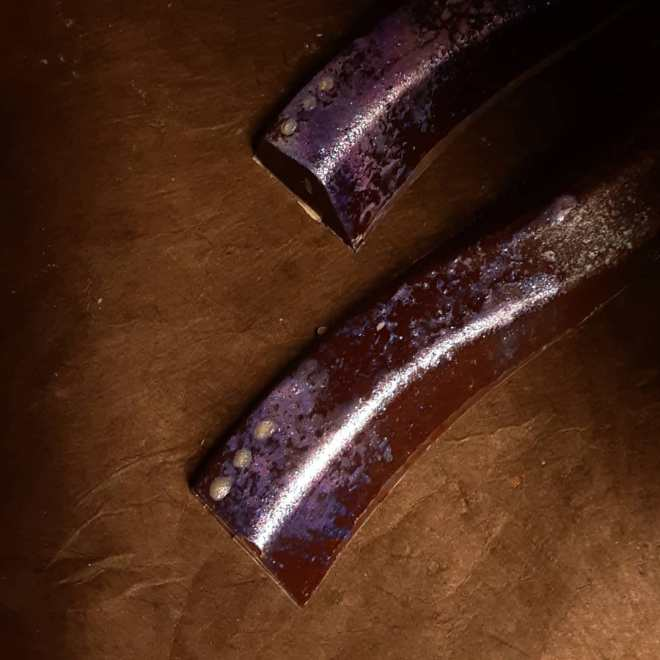 THINGS I LIKE: blueberry and cherry cloud caramel with fruity Tanzania dark chocolate in a dark milk shell.#chocolatier #sparkle #fruitand the things I like happen to be purple and sparkly. -Rachel
