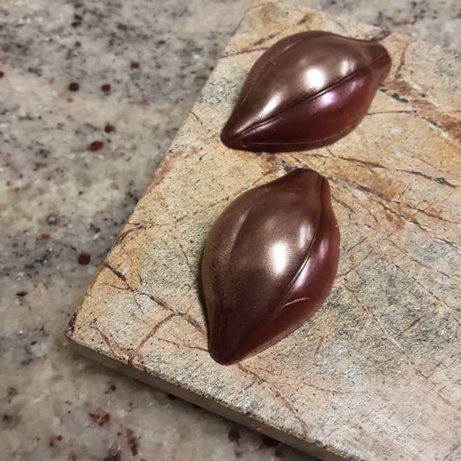 CARAMEL UPON CARAMEL UPON CARAMEL: citrus and chili cloud caramel in housemade Puerto Rican dark chocolate #chocolatier #citrus #chiles One thing flowing into the next, a metamorphosis, an evolution. A bonbon.