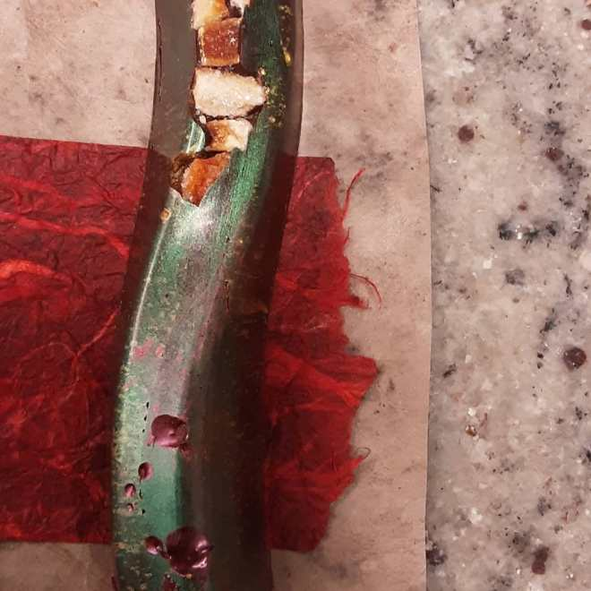 SCENE OF THE CRIME - crisp blood orange with cherry & blood orange caramelized ganache in chocolate noir. #chocolatier #filmnoir Just a touch of evil.