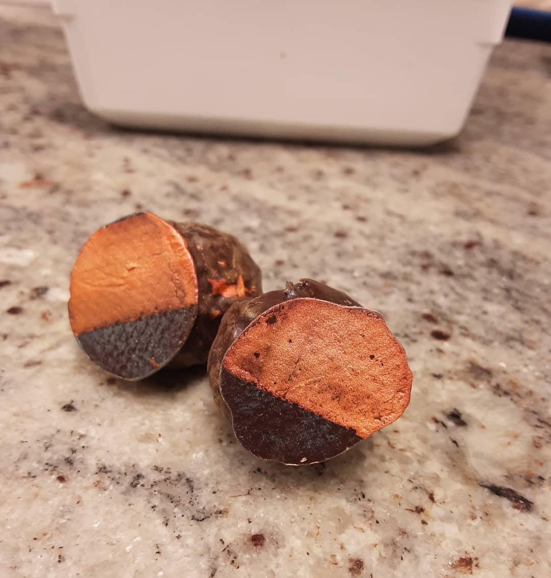 VIEW FROM INSIDE THE WHALE - Etrog Citron caramelized ganache truffle. #chocolatier #chocolatetruffles #truffesauchocolat #etrog Conveniently perfect timing. Pass the matzo? (Where *did* that matzo go?)