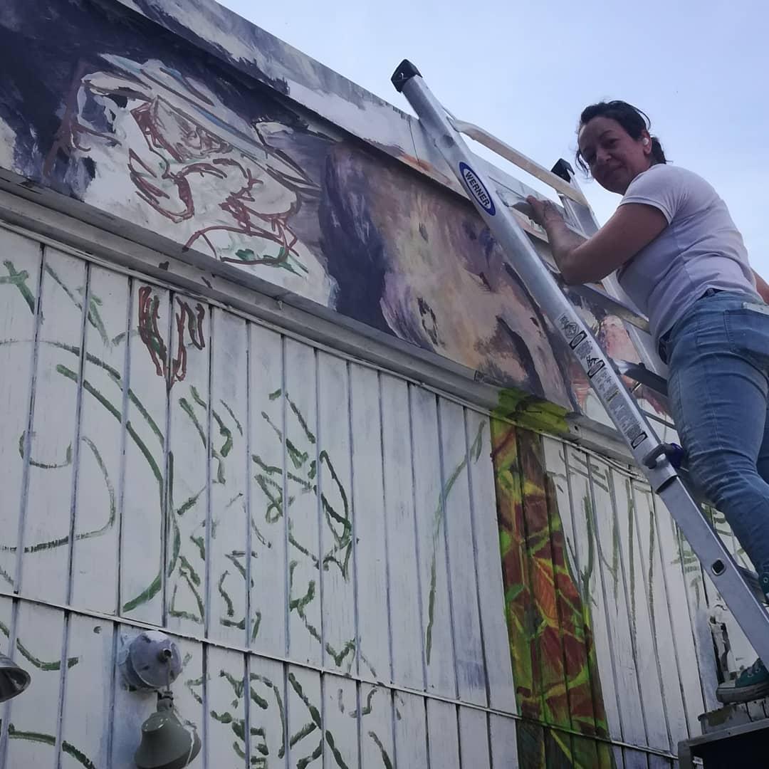 Yasamin working on the OLMEC part pf tne shop's mural project .#chocolatier #manchesternh #streetart #mural #artistatwork