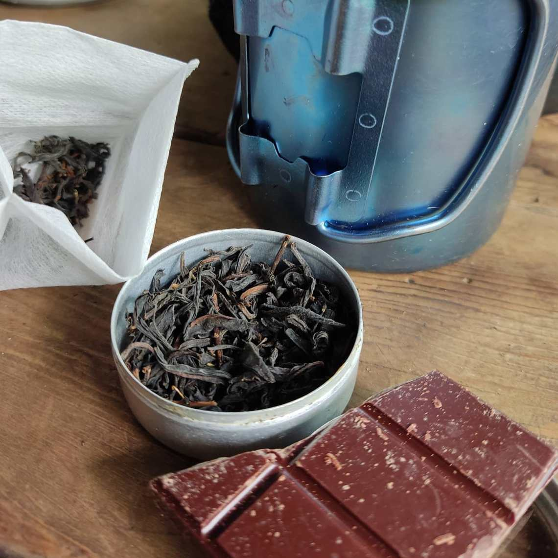 CHOCOLATE and Formosa Mixiang black tea, and because a week backpacking doesn't mean roughing it. The sure is poor house made Tanzania. #chocolatier #appalachiantrail @redblossomteacompany #trailfood