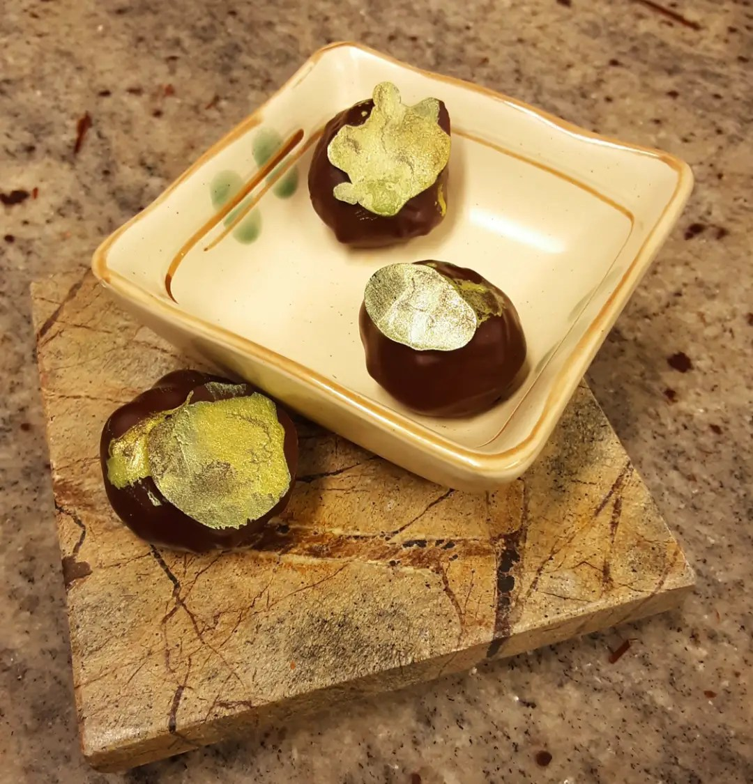 GLASS GREEN: soft dark milk ganache with two kinds of green tea.#chocolatier #greentea #chocolatetruffles #glass in our fiction lies the truths, a story told is all but false, make believe roots deep reality, and the glass shines vivid green