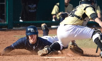 Penn State redshirt freshman Ryky Smith (33), left, scores the tying run in the bottom of the ninth inning, beating out the tag from Purdue catcher Jack Picchiotti (31) during an NCAA baseball game at Medlar Field in University Park, Pa. on Sunday, March 30, 2013. The Boilermakers defeated the Nittany Lions 5-4 in 10 innings. Photo by David Andrews.