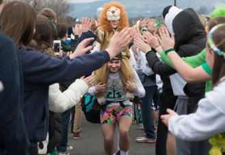 THON 2013, Penn State's annual 46-annual dance marathon to raise money and awareness for pediatric cancer, kicks off on Friday, February 15, 2013 when the 700+ dancers enter Penn State's Bryce Jordan Center through a human tunnel of committee members, called moralers, who are assigned to assist each dancer throughout the weekend. Photo by David Andrews.