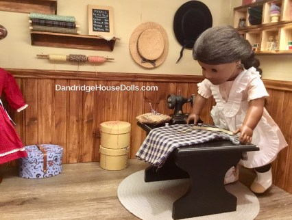 Addy cutting fabric for a customer.