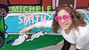 Michele Smith petting cartoon dog