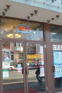 Toronto-Danforth candidate's campaign poster in Chinatown East window