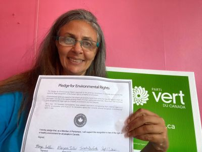 Maryem Tollar with signed Pledge for Environmental Rights.