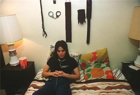 Joan Jett on her bed in LA 1977