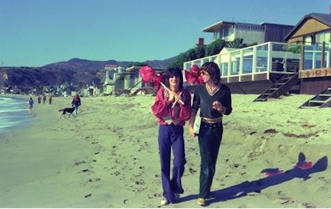 Mick Jagger and Ron Wood walking the beach