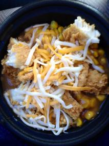 KFC's famous bowl!! It consists of mashed potatoes topped with popcorn chicken, corn, gravy, and cheese! (KFC=Kentucky Fried Chicken).