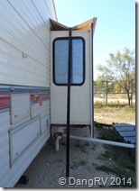 Slide-out awning tie down