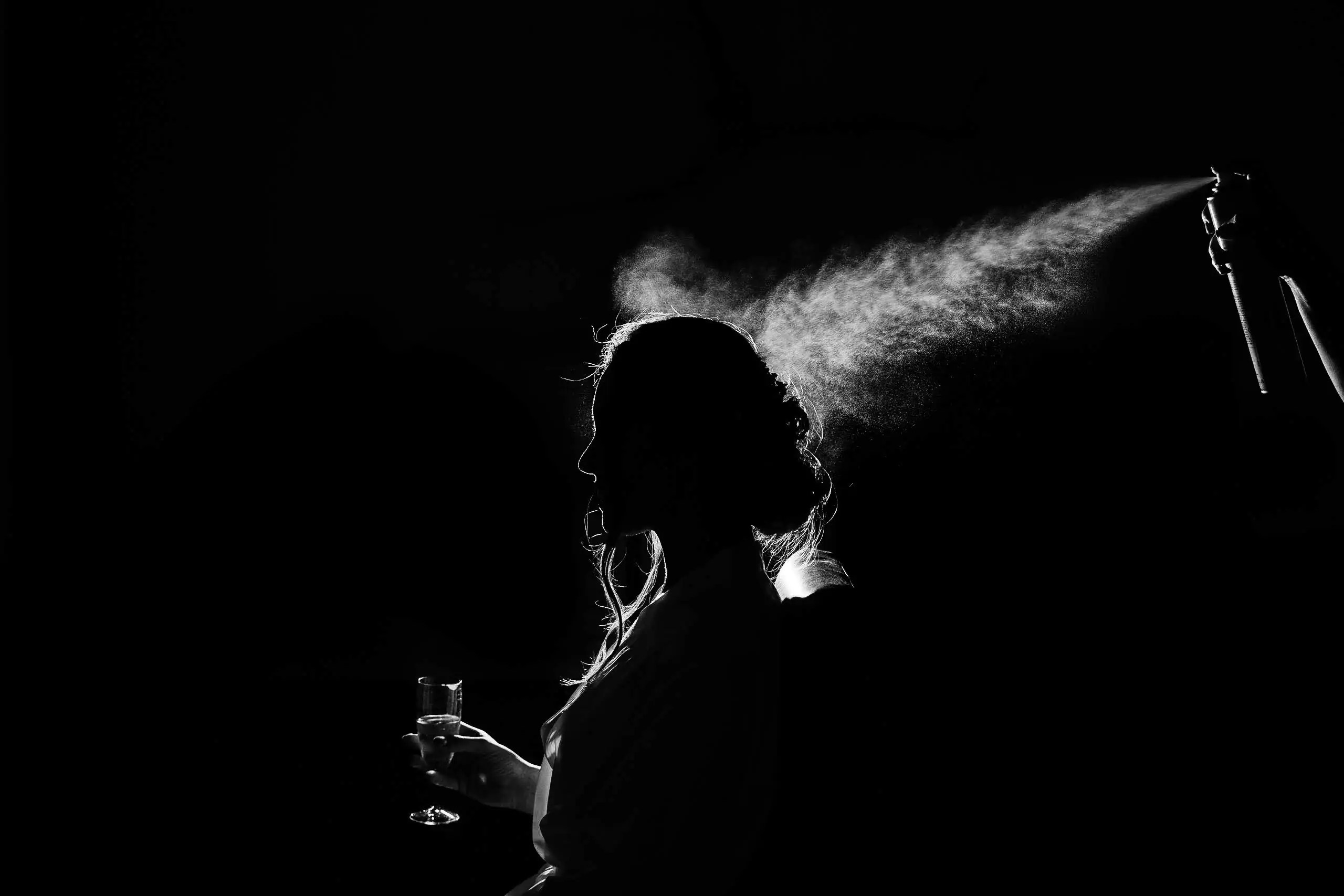 An artistic black and white shot of a bride during bridal preparations