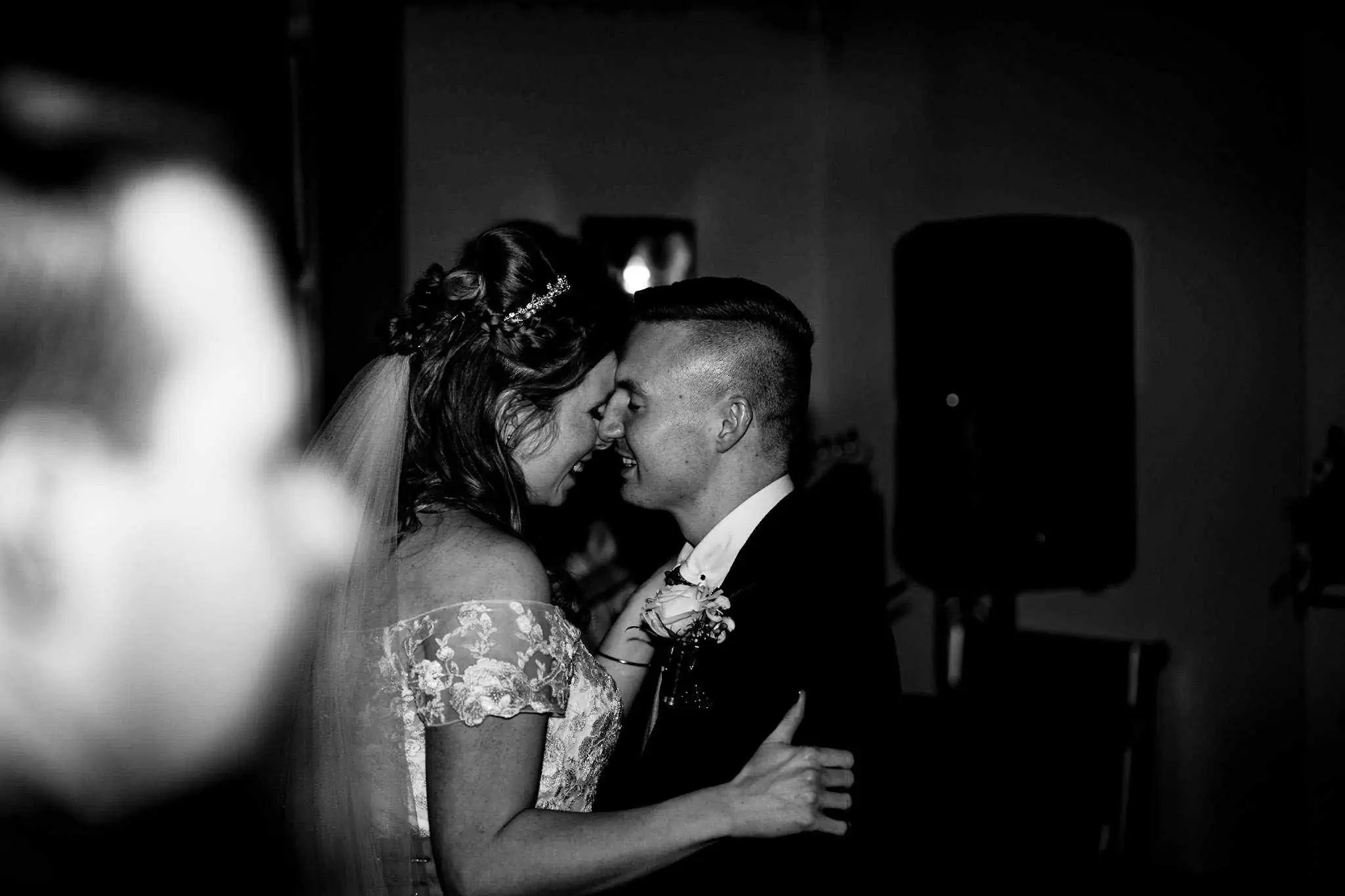 A bride and groom sharing an intimate moment during their first dance