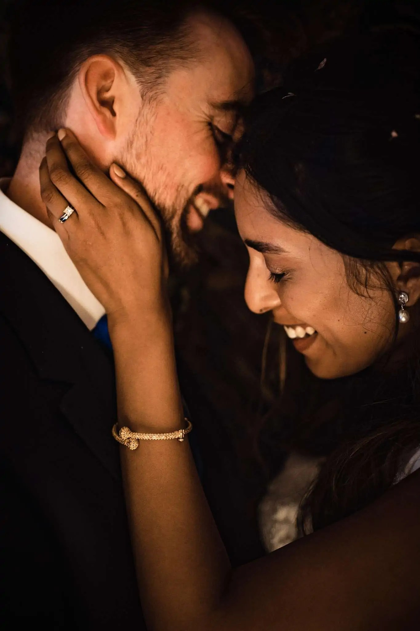 A bride and groom sharing an intimate moment during their couple portraits