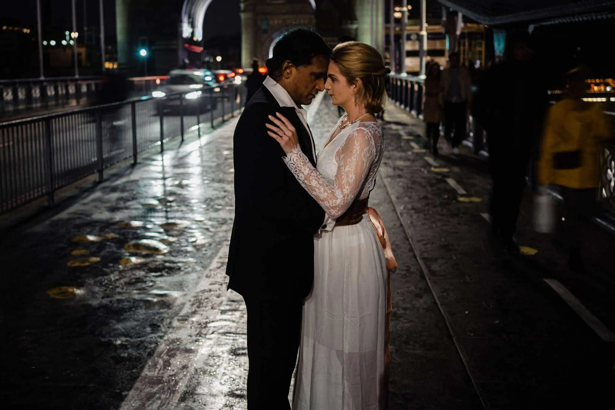 A bride and groom stare into each others eye on Tower Bridge, London