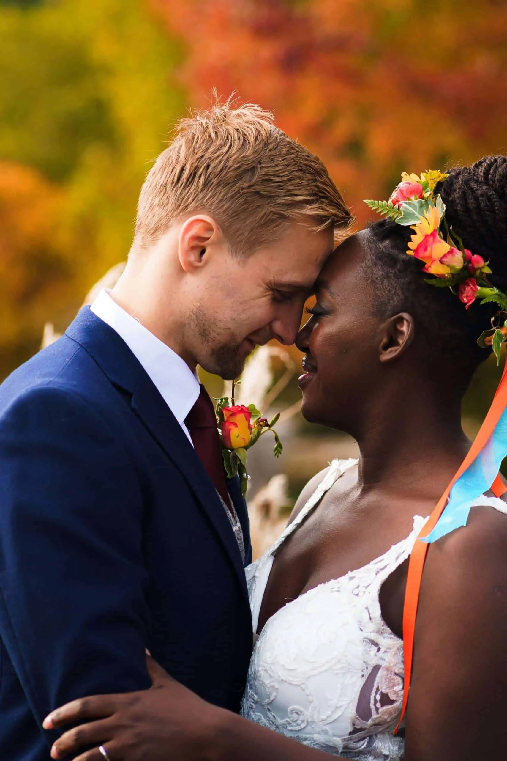 A bride and groom share a tender moment during their wedding