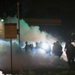 protesters-swat-standoff-si-credit-reuters