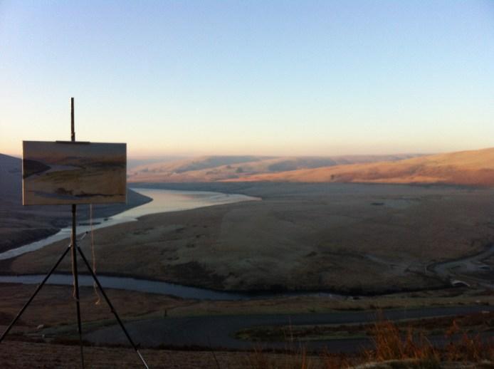 Soft winter sun rising up over Craig Goch reservoir
