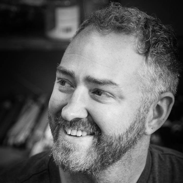 Black and white image of Daniel smiling. My approach is kind, non-judgmental and dynamic. I am trained in psychodynamic counselling, which specialises in how we humans get along with each other, and how we can be affected by our past.  I'm also trained in working with trauma. Including understanding how the body responds emotionally and physically to stress.