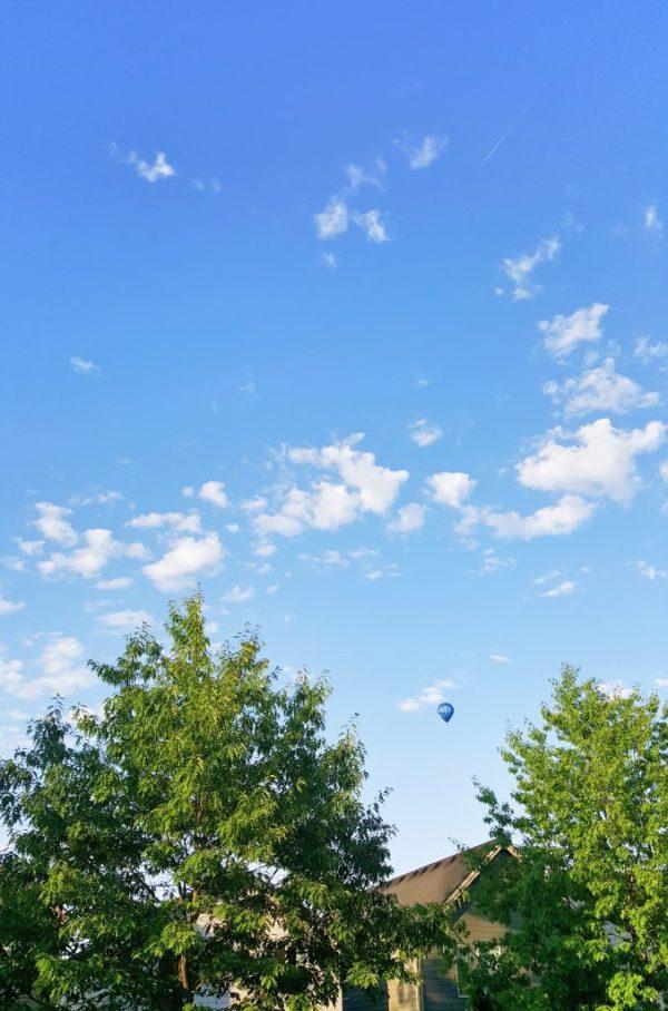 hot air balloon blue skies