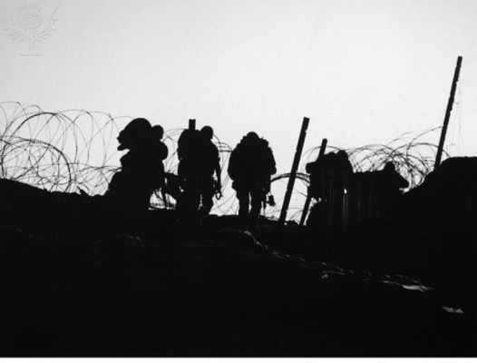 VIETNAM WAR: OVER THE TOP. American soldiers pass though strands of barbed wire at Fire Support Base Blaze in A Shau Valley, South Vietnam, 1969.