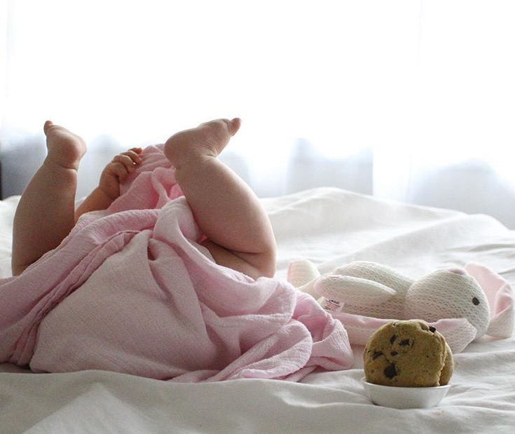 baby-playing-with-swaddled-lactation-cookies