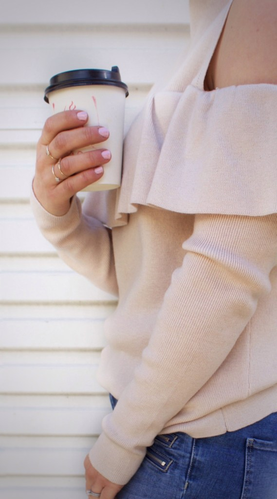 holding coffee cup nails panted pale pink miss frankie sweater with shoulder cutout and frill