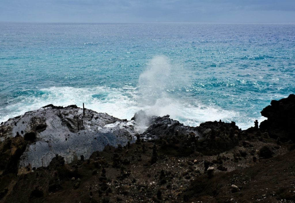 Halona Blowhole shoots ocean water through a lava tube
