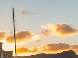 Diamond Head at sunset is visible at Waikiki