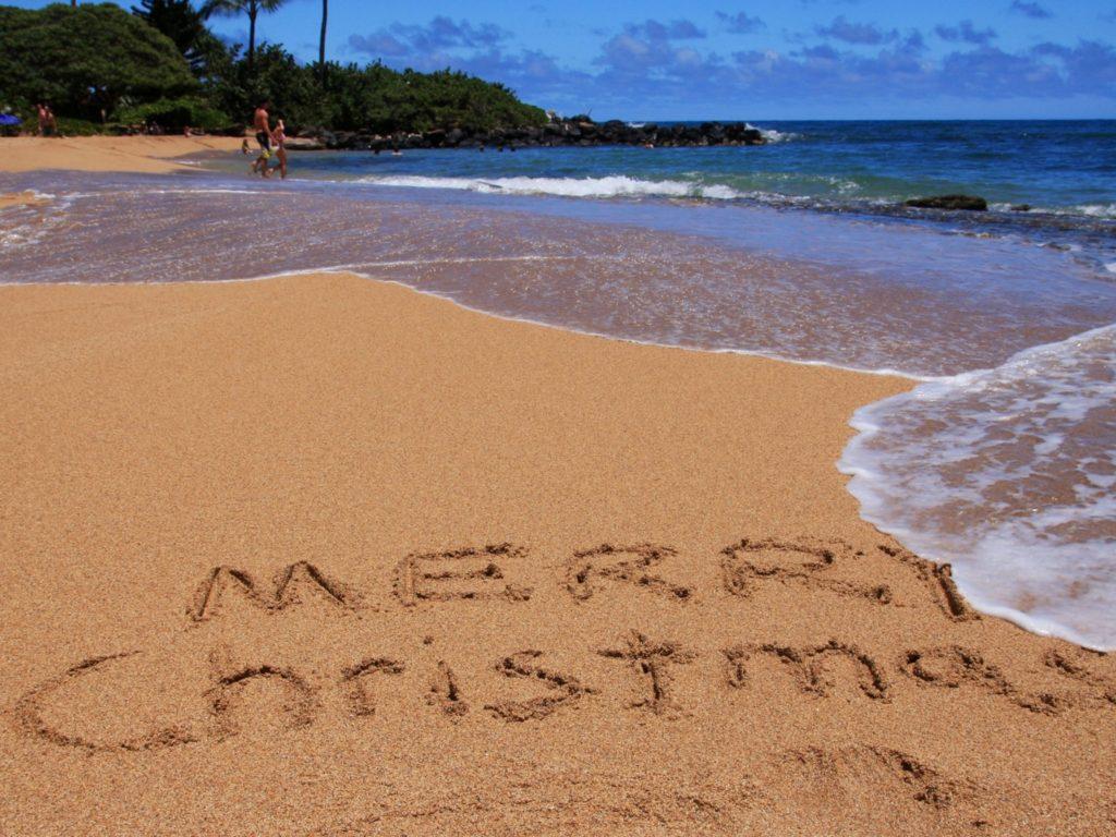 Merry Christmas written on a Kauai beach.