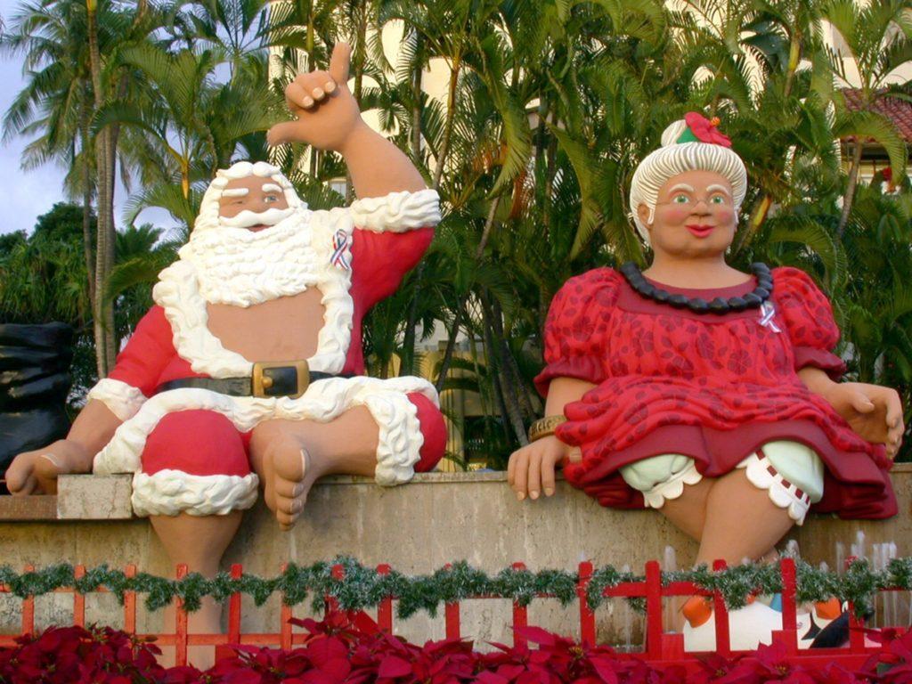 Shaka Santa and Tūtū Mele greet you at Honolulu City Lights.