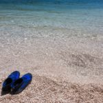 Swimming shoes are what to pack for a beach day in Hawaii