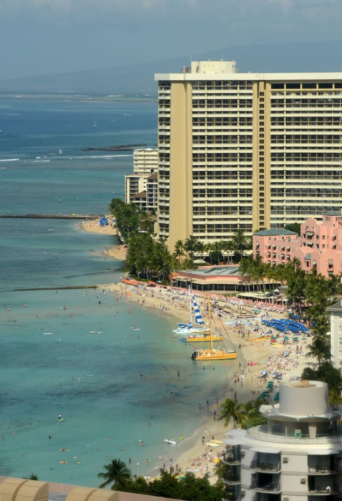 How bad is a vacation in Hawaii in 2021? You will see crowds on Waikiki Beach.