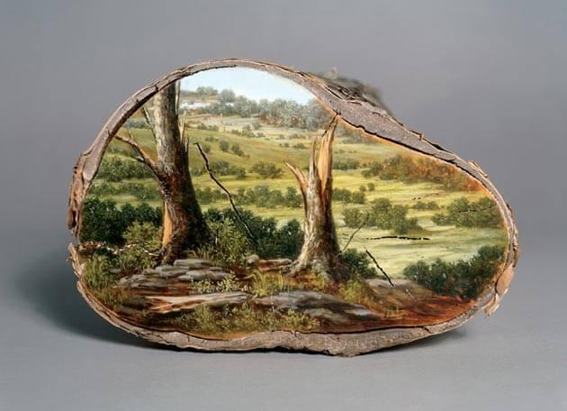 Paintings on tree logs mirror their origins