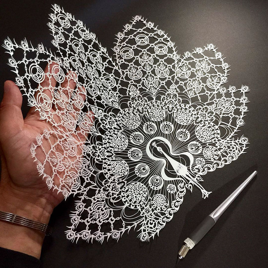 Mr. Riu's amazingly delicate and detailed hand-cut paper art