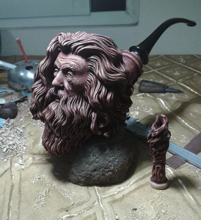 Sculptor turns blocks of wood into intricately detailed pipe of Gandalf