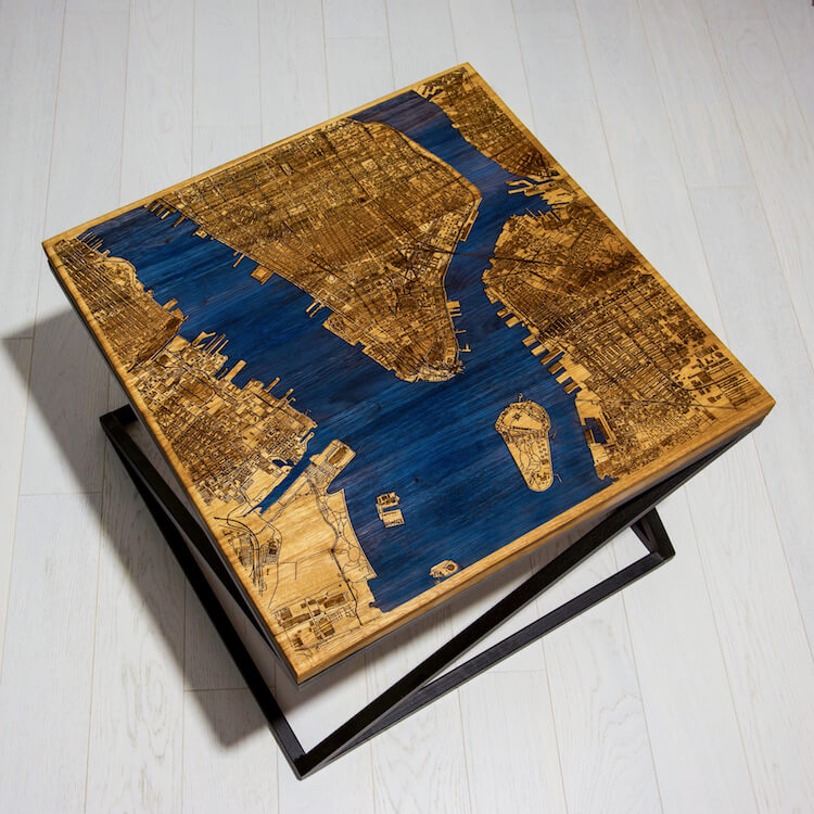 Glow-in-the-dark tables display engraved city maps