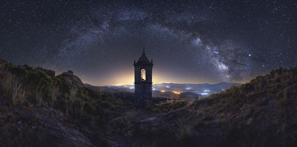 An old monastery under the Milky Way in the Spanish mountains