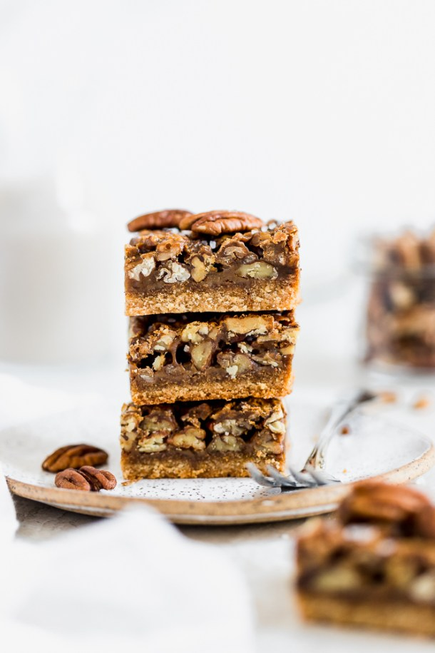 Stack of paleo pecan pie bars.