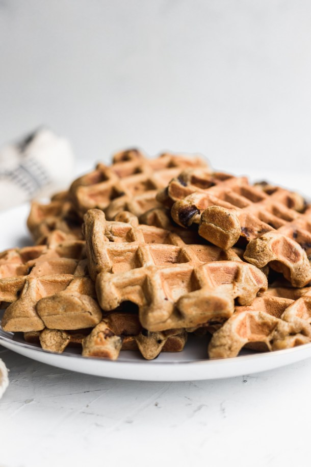 Stack of peanut butter banana chocolate chip waffles.