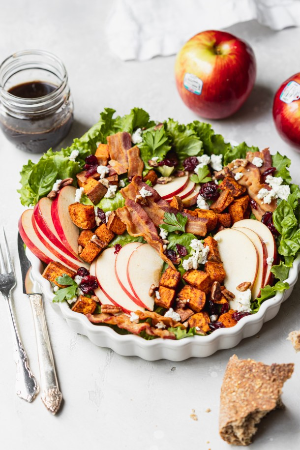 A delicious fall inspired salad that features Rave® apples, the outrageously juicy Honeycrisp cross, spiced roasted sweetpotatoes, pecans, herb goat cheese, dried cranberries, and bacon.