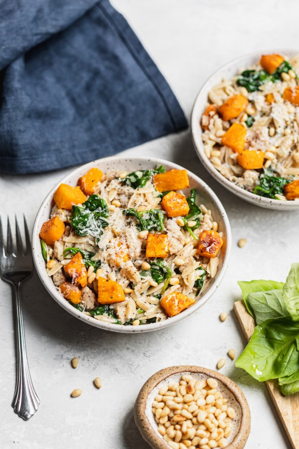 This Fall orzo salad features perfectly el dente whole wheat orzo, roasted butternut squash, apple chicken sausage, and garlic sautéed spinach and kale tossed with lemon juice and olive oil.