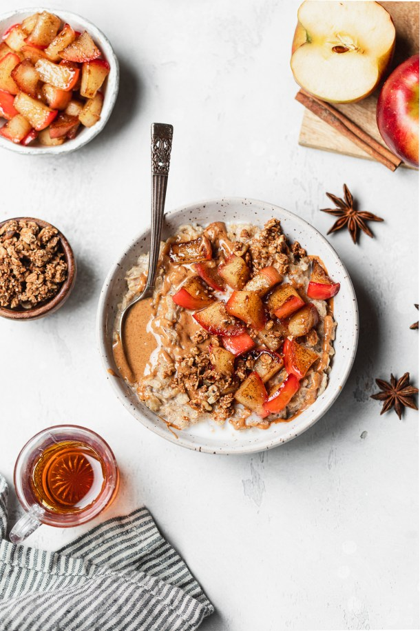 Maple brown sugar oats topped with creamy almond butter and apples sautéed in plant-based butter and flavored with maple syrup and cinnamon.