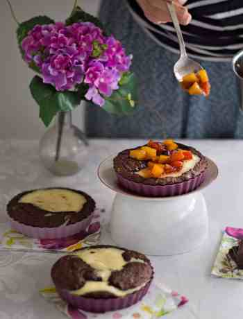 Very easy and elegant Cream Cheese Brownie Tarts with Peach Garnish. Find the complete recipe at daniscookings.com