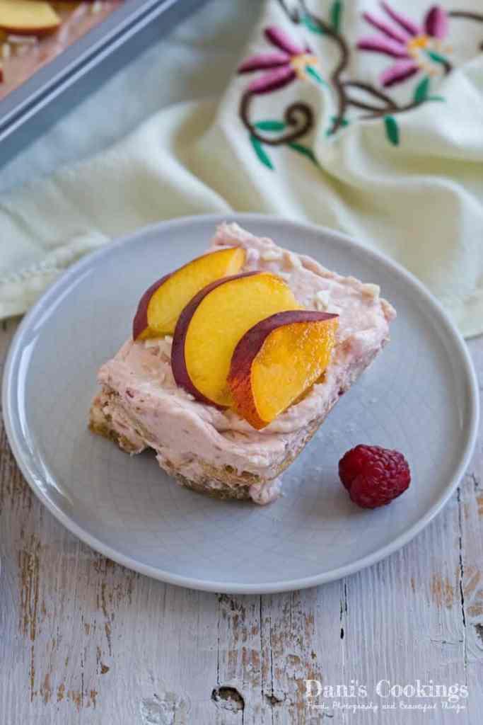 Peach Raspberry Tiramisu slice on a plate
