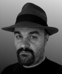 A black and white picture of dan in a fedora hat on plain background